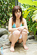 Japanese teen Uri bares small tits and shaved pussy in garden