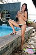 Long haired beauty Keira Lee stripping bikini beside pool