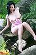 Busty beauty Nancy Ho strips on rock and bares big breasts