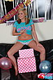 Birthday blonde Tegan Brady stripping on couch with balloons
